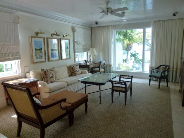 Living room area in One Bedroom Oceanview Suite at Regent Palms