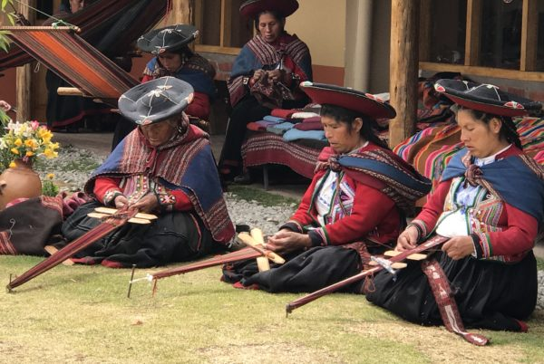 Learning about traditional weaving techniques in Chinchero