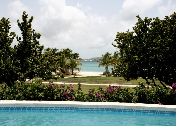 Poolside view from a Rosewood Estate Suite at Jumby Bay